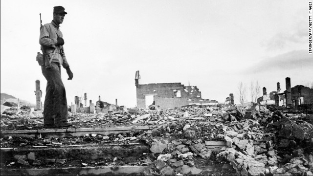 An American soldier walks around the rubble of Hamhung, North Korea, in an undated photo. On June 30, 1950, President Harry S. Truman ordered American troops into the fighting.