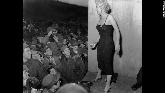 Actress Marilyn Monroe entertains troops, circa 1952.