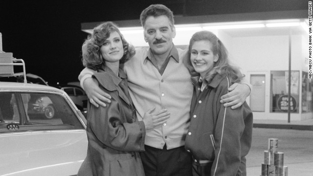 "Hanna Cox, from left, Farina, and Julia Roberts pose for a photo on the set of the TV show ""Crime Story"" in 1987."