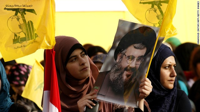 Women hold Hezbollah flags and a picture of the movement's chief, Hassan Nasrallah, in Lebanon on May 25.