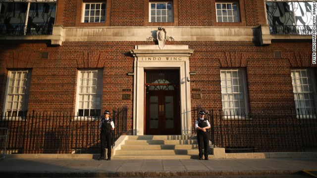 Police guard the Lindo Wing at St. Mary's Hospital in London as crowds gather and await news of the birth of the first child of the Duke and Duchess of Cambridge on July 22.