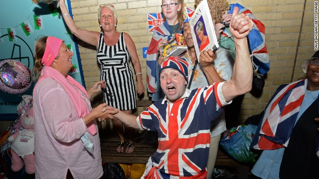 Royal fans celebrate the announcement of the birth of a boy to the Duke and Duchess of Cambridge at St. Mary's Hospital in London on July 22.