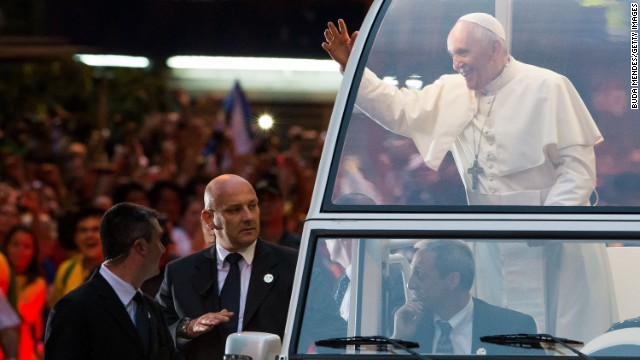 Pope Francis and his security escorts depart the Metropolitan Cathedral in Rio on July 22.