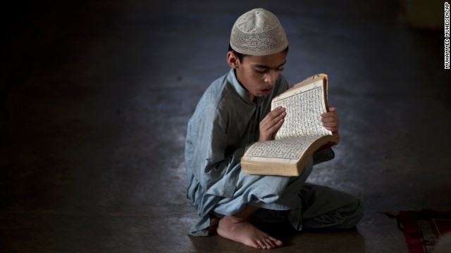 A Pakistani student of a madrassa, or Islamic school, attends a test in reciting verses of the Quran in Islamabad, Pakistan, on Monday, July 22.
