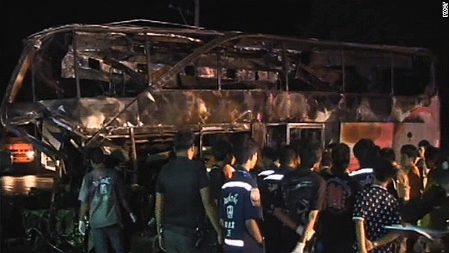 The charred remains of the ill-fated bus are pictured on Tuesday.