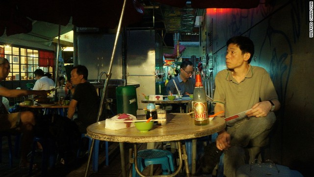 A diner waits for his meal at a dai pai dong in Hong Kong's central district on June 21, 2013. Once a common fixture of Hong Kong street life, now only 28 licensed dai pai dong remain in the city.