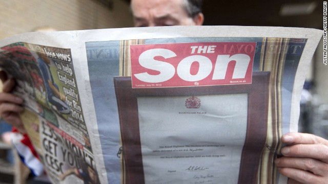 "A man reads a copy of British tabloid The Sun, renamed ""The Son,"" on July 23."