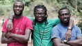 Emeka, Jide and Emmanuel in the mud, Ekok Road, Cameroon