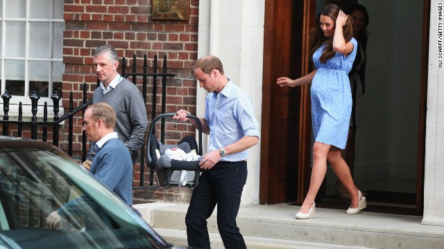 The new parents leave the hospital with William carrying the boy out in a car seat and installing him in the back of a black SUV for the trip to Kensington Palace.