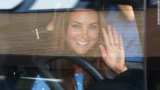 Catherine waves to the crowd gathered outside the hospital.