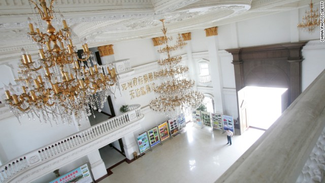 "The interior of a government building referred to as the ""White House"" by locals in Anhui province. The construction of the building was made possible through the demolition of a local school and the repossesion of farming land."