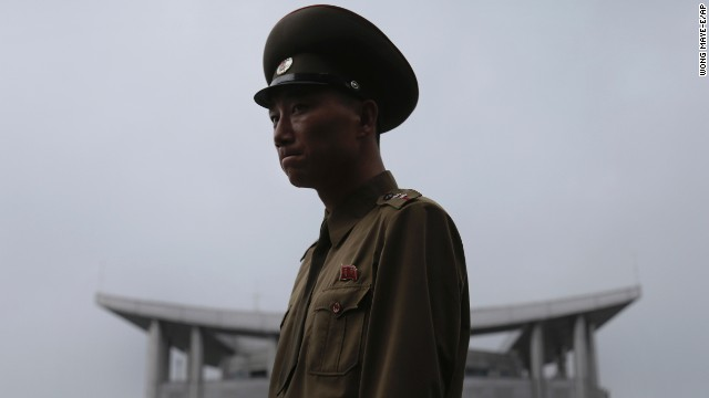 A North Korean soldier explains the history of the armistice agreement between North and South Korea at the truce village of Panmunjom in the demilitarized zone on Monday, July 22. The demilitarized zone separates the two Koreas and remains one of the most tense borders in the world.