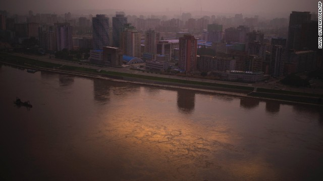 At dusk, the setting sunlight is reflected on the Taedong River in Pyongyang on Sunday, July 21.
