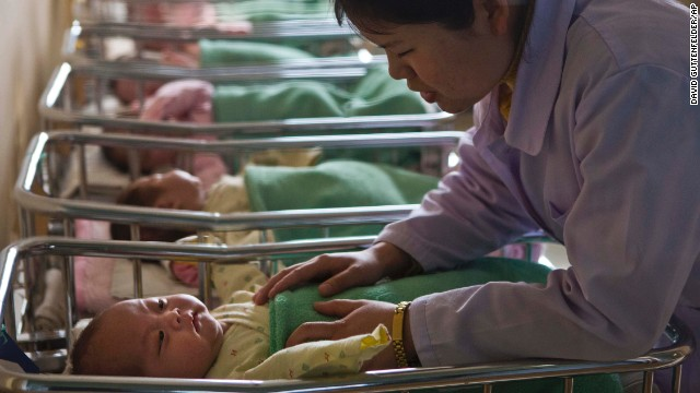 A nurse comforts a baby at a nursery inside Pyongyang Maternity Hospital in Pyongyang on Wednesday, February 20.