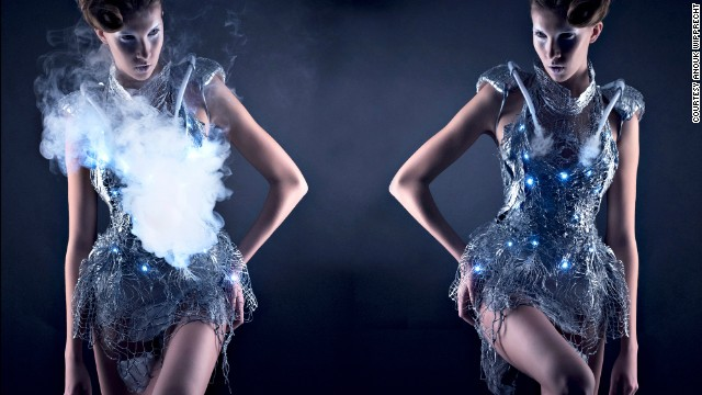 "Don't like strangers approaching you? Then the Smoke Dress is a must-have. Designed by <a href='http://www.anoukwipprecht.nl/' target='_blank'>Anouk Wipprecht</a>, the dress can suddenly visually obliterate itself through the emission of a cloud of smoke. Ambient clouds of smoke are created when the dress detects a visitor approaching, thus camouflaging itself within it's own materiality. Perfect if you are a fashionable socialite AND a misanthrope. "" border=""0″ height=""360″ id=""articleGalleryPhoto006″ style=""margin:0 auto;display:none"" width=""640″/><cite style="