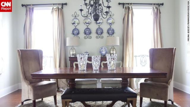 <a href='http://ireport.cnn.com/docs/DOC-1007371'>Norwood's</a> kitchen opens up to a large eating area, which she kept semiformal and comfortable with an eclectic collection of chairs.