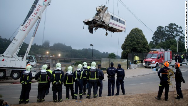 A car from an express train that crashed is lifted Thursday, July 25, at Angrois near Santiago de Compostela, Spain. The train derailed as it hurtled around a curve at high speed on Wednesday, July 24.