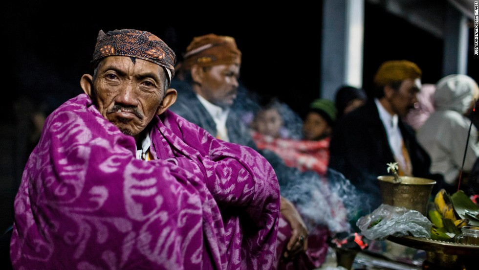 A Tenggerese shaman, celebrating the Yadnya Kasada Festival, sits at a temple near the crater of Mount Bromo on July 24, 2013 in Probolinggo, East Java, Indonesia. Yadnya Kasada is the main festival of the Tenggerese people and lasts about a month.