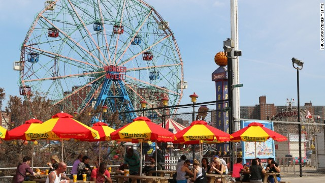 Coney Island's iconic Wonder Wheel looms over the boardwalk and amusement park