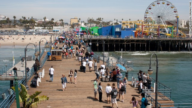 The Santa Monica Pier hugs the Pacific coast.