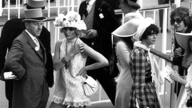 Swinging sixties fashion mixes with the traditional top hat in this shot taken at Royal Ascot in 1968.