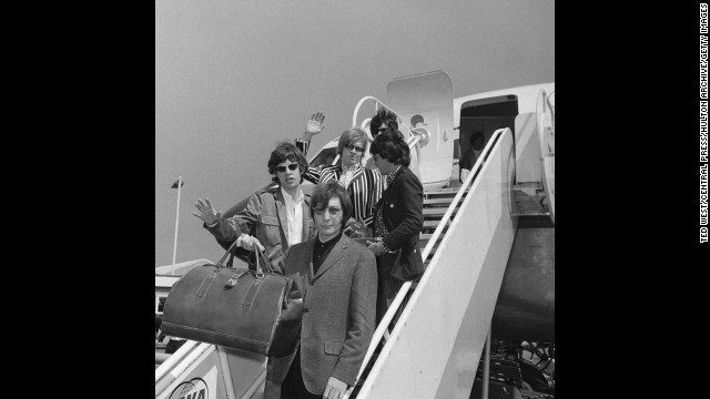 The Rolling Stones leave London on a flight to New York on June 23, 1966, before the start of their fifth North American tour.