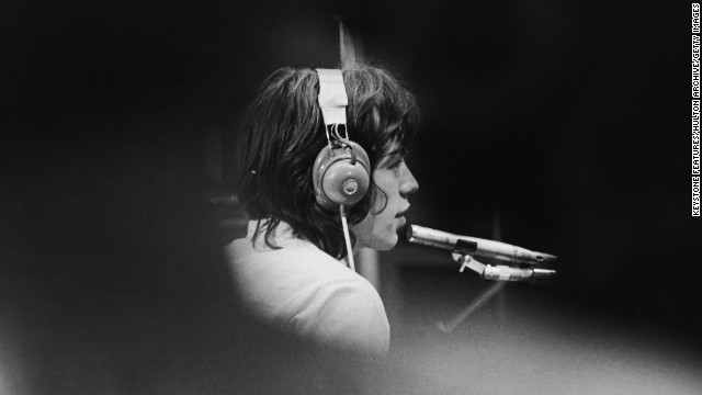 "Mick Jagger sits in a London recording studio during the filming of French director Jean-Luc Godard's ""Sympathy For the Devil"" in 1968."
