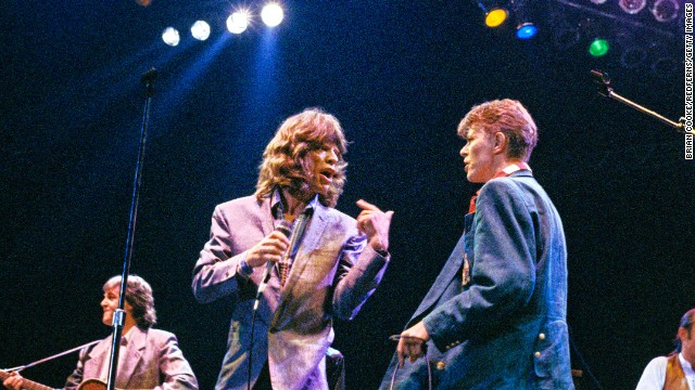 From left, Paul McCartney, Mick Jagger and David Bowie take the stage together at London's Wembley Arena in 1986.