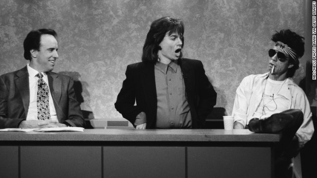 "From left, Kevin Nealon, Mike Myers as Mick Jagger, and Mick Jagger as Keith Richards do a ""Weekend Update"" skit on ""Saturday Night Live"" in 1993."