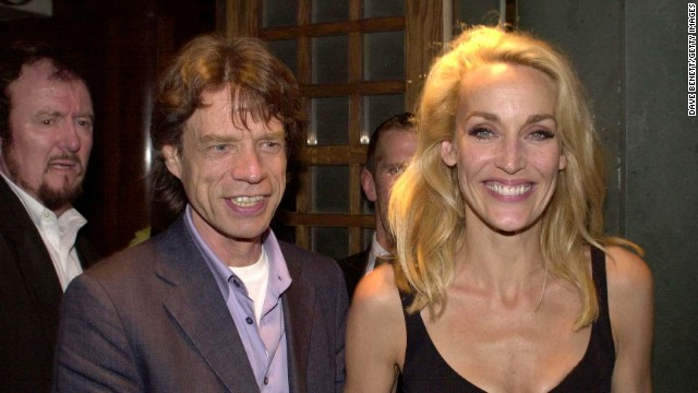 "Mick Jagger and Jerry Hall leave The Ivy Restaurant in London after Hall's debut in the stage production of ""The Graduate"" in 2000."