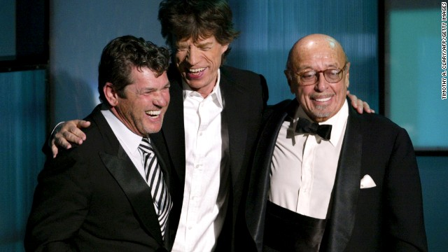 Rolling Stone magazine founder Jann Wenner, left, is presented his award by Mick Jagger and Ahmet Ertegun during the 2004 Rock and Roll Hall of Fame induction ceremony in New York.