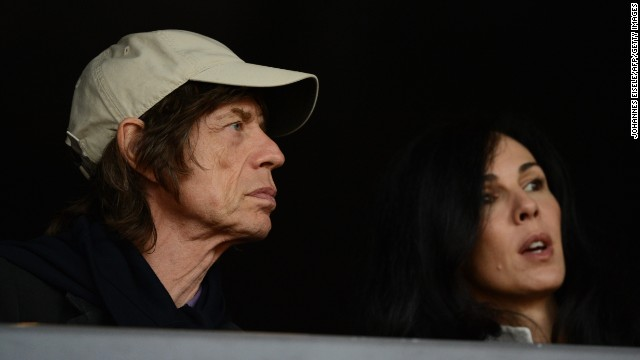 Mick Jagger watches the 2012 Olympic Games in London with his girlfriend, American fashion designer L'Wren Scott.