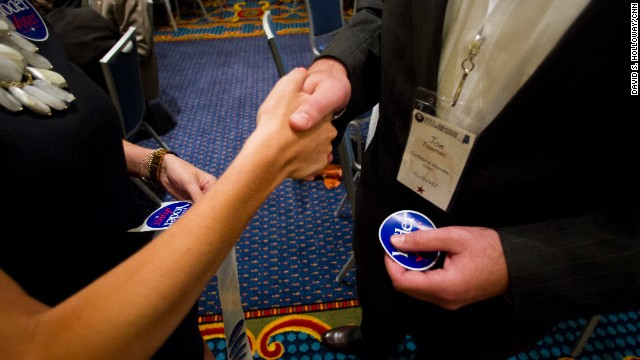 "Ashley Moretti passes out ""Yoder Voter"" stickers in support of Rep. Kevin Yoder of Kansas, a Young Republican and one of the convention speakers."