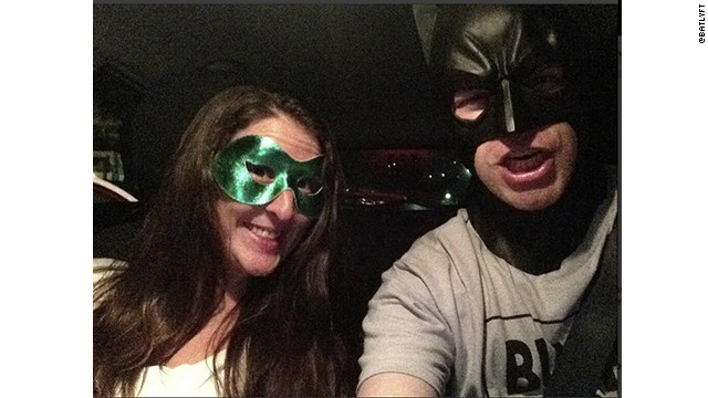 Actor Jimmy Lucia dons a Batman mask for his Lyft shifts. Passengers can try on other masks and take their own pictures with the car's camera.