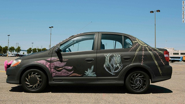 Lyft driver Grant Gordon leaves a giant box of chalk on his chalkboard car when he parks in San Francisco. He returns to find the car covered in drawings and messages.