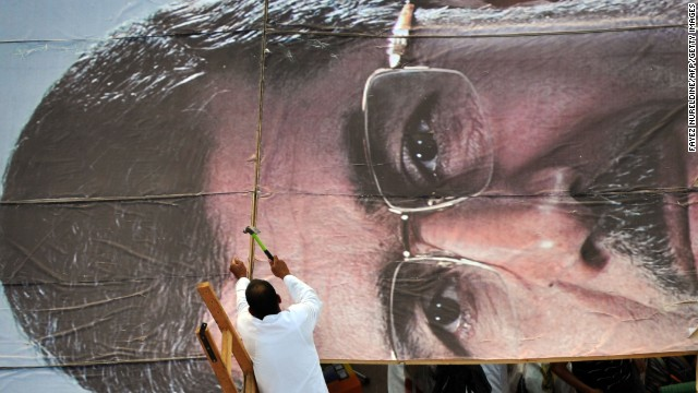 A Morsy advocate builds a giant portrait of the deposed president Thursday, July 25, while other supporters hold a sit-in outside a Cairo mosque. T