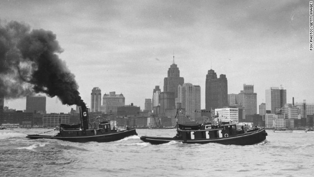 Tugboats race on the Detroit River in 1954.