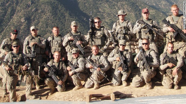 "Carter poses with his comrades from Blue Platoon, also known as ""The Bastards,"" at Observation Post Fritsche in Afghanistan."