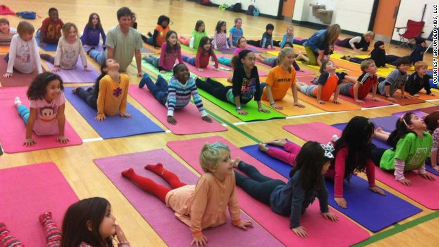 Elementary school students in Dekalb County, Georgia, practice the cobra pose, which is designed to relieve discomfort in the muscles of the back, neck and abdomen. It also aims to alleviate stress, anxiety and depression.
