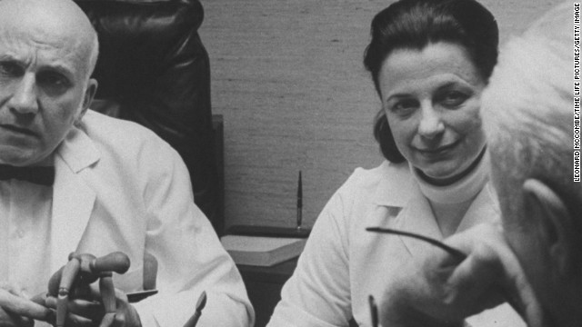 Virginia Johnson and her partner, William Masters, confer with patients during a marriage counseling session