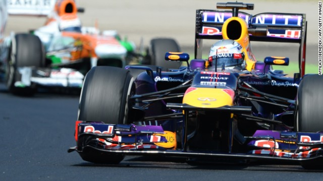 Sebastian Vettel in his Red Bull leads the Force India of Adrian Sutil in practice for the Hungarian Grand Prix.