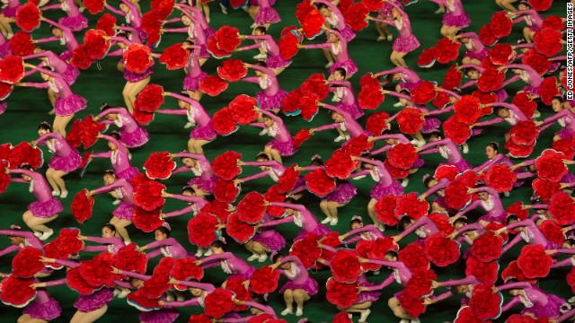 Dancers with flower props create a sea of color and movement on July 26.