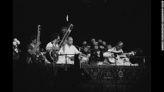 The Concert for Bangladesh takes place in August of 1971. Tanpura player Kamala Chakravarty, sitar player Ravi Shankar, tabla player Alla Rakha and sarod player Ali Akbar Khan perform.