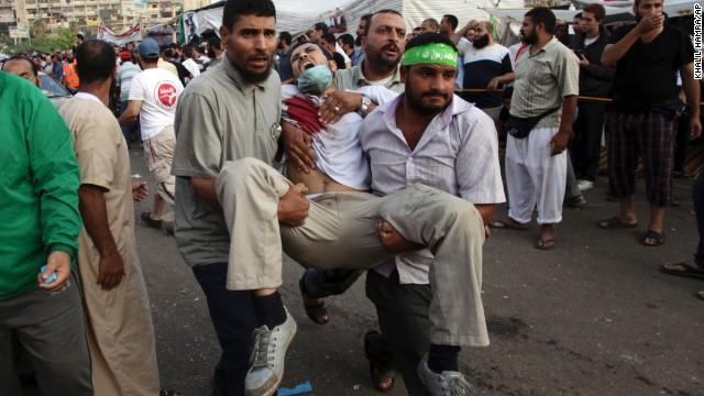 Supporters of deposed Egyptian President Mohamed Morsy carry an injured man to a field hospital amid clashes with security forces in Cairo on Saturday, July 27. The military ousted Mohamed Morsy, Egypt's first democratically elected president, in early July after days of mass demonstrations. <a href='http://www.cnn.com/2013/06/29/middleeast/gallery/egypt-protest/index.html'>See photos of protests that have engulfed the country.</a>