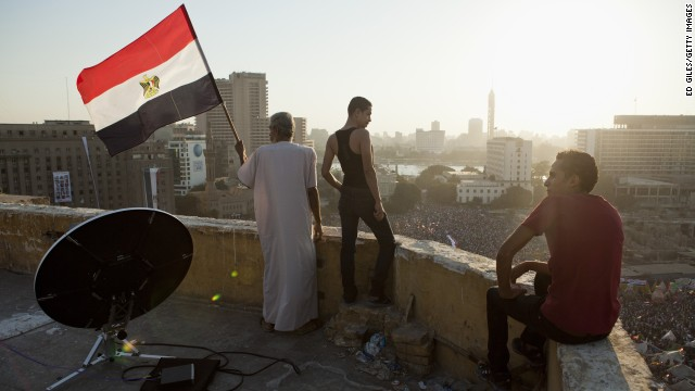 Morsy opponents watch a demonstration from a rooftop near Tahrir Square in Cairo on July 26.
