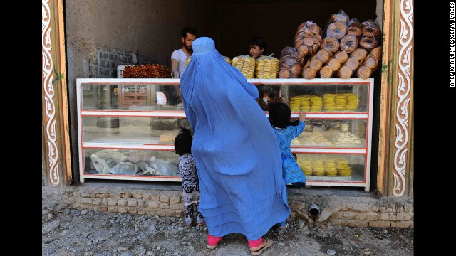 A woman buys sweets in Herat, Afghanistan, on July 27.