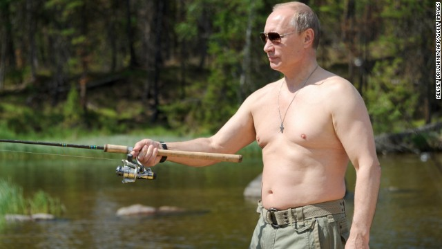 Putin enjoys some fishing during his vacation to the Tuva region on July 20, 2013. For years, Russia's leader has cultivated a populist image in the Russian media.