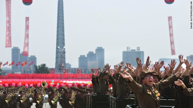 North Korean veterans wave to Kim Jong Un during the parade on July 27.