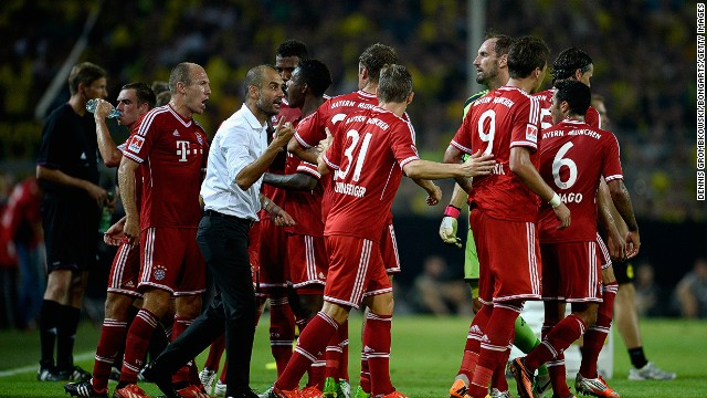 Pep Guardiola encourages Bayern Munich players during the match at the Signal Inuna Park.