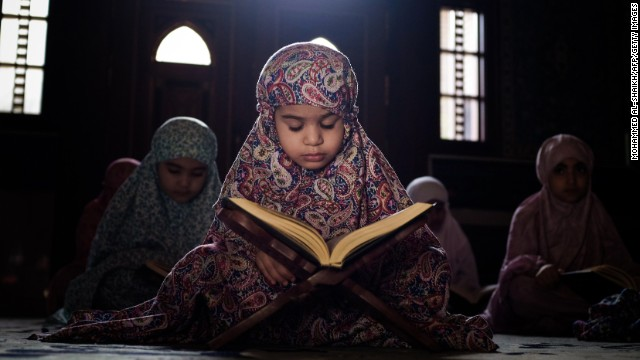Girls read the Quran at a mosque in Sanabis, Bahrain, on Saturday, July 27.